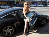 Lindsay Lohan shows legs in short denim shorts and black top as she and Samantha Ronson have a burger in Hollywood
