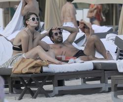 http://img243.imagevenue.com/loc574/th_312377107_Mischa_Barton_Bikini_Candids_on_the_Beach_in_Miami_December_27_2011_178_122_574lo.jpg